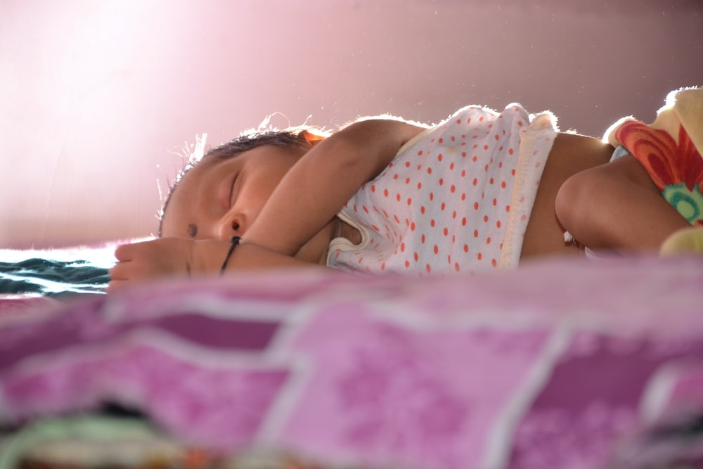 shallow focus photo of baby sleeping