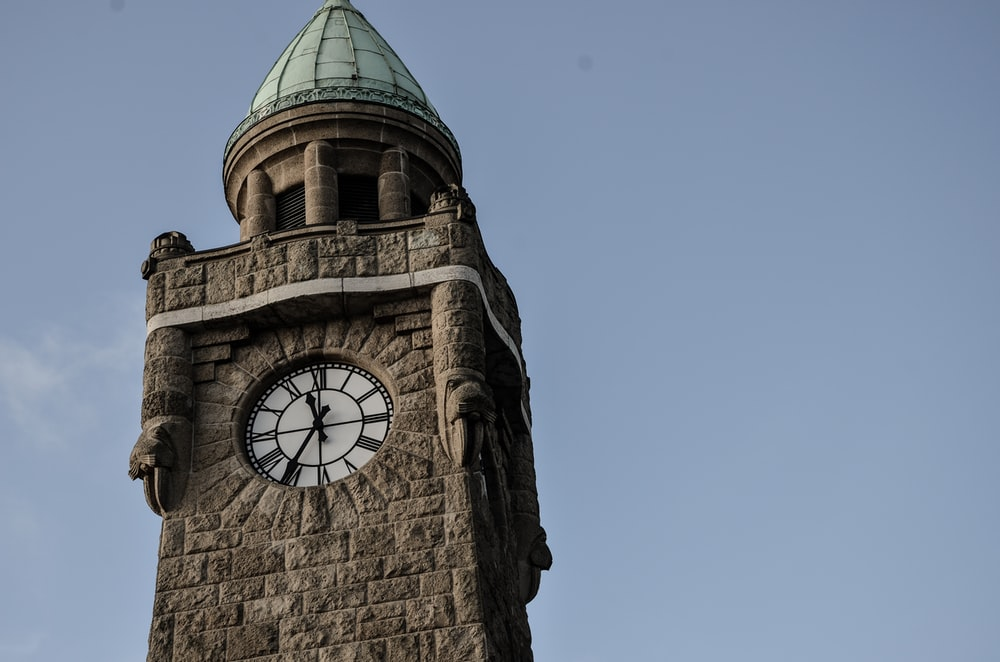 brown analog tower clock