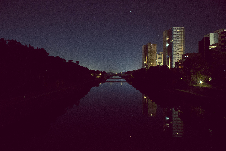 calm body of water between buildings