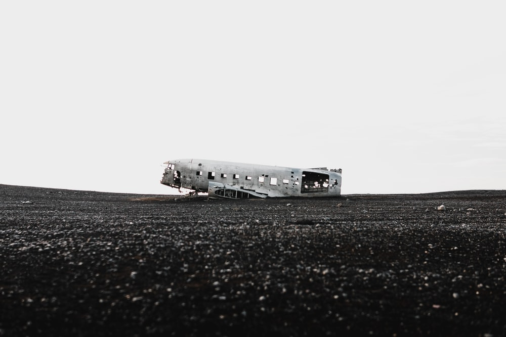 greyscale photo of wrecked airplane