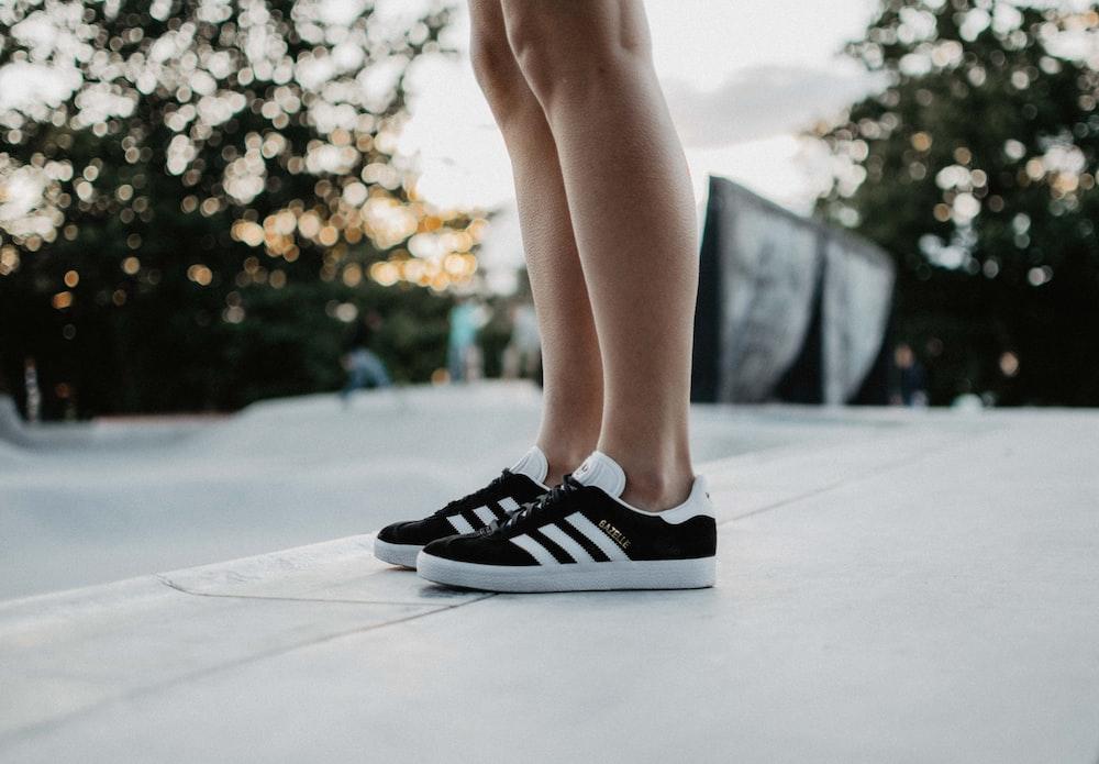 black adidas low-top sneakers