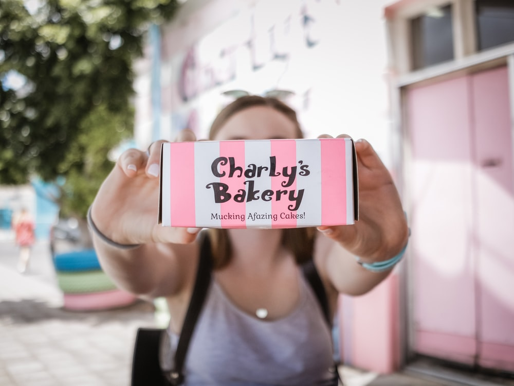 woman holding Charly's Bakery box