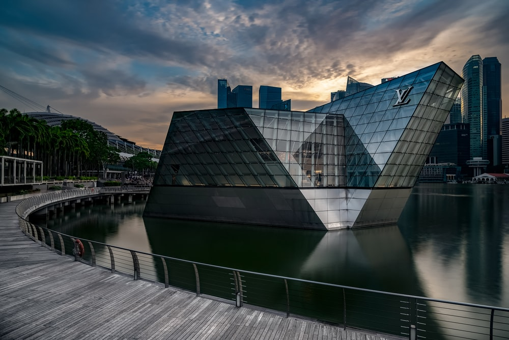 Louis Vuitton building surrounded by body of water