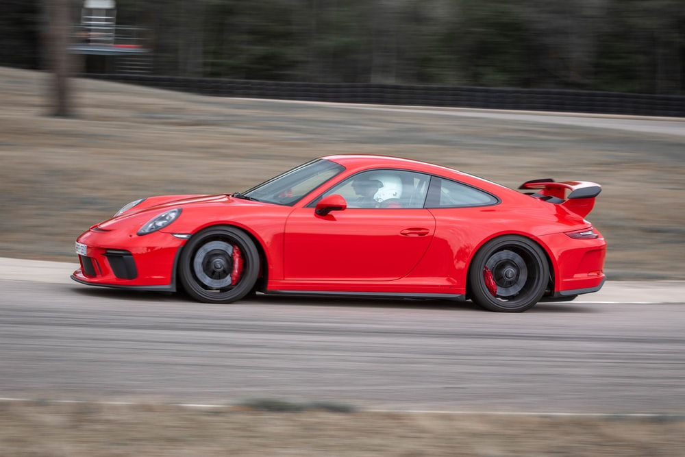 panning photography of red coupe
