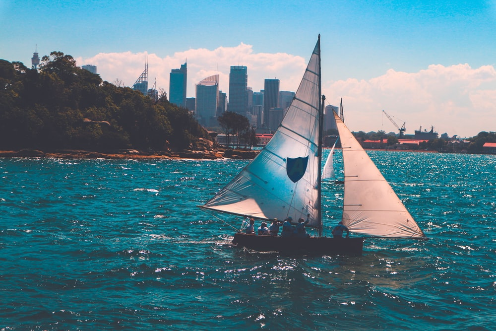people on white sailboat