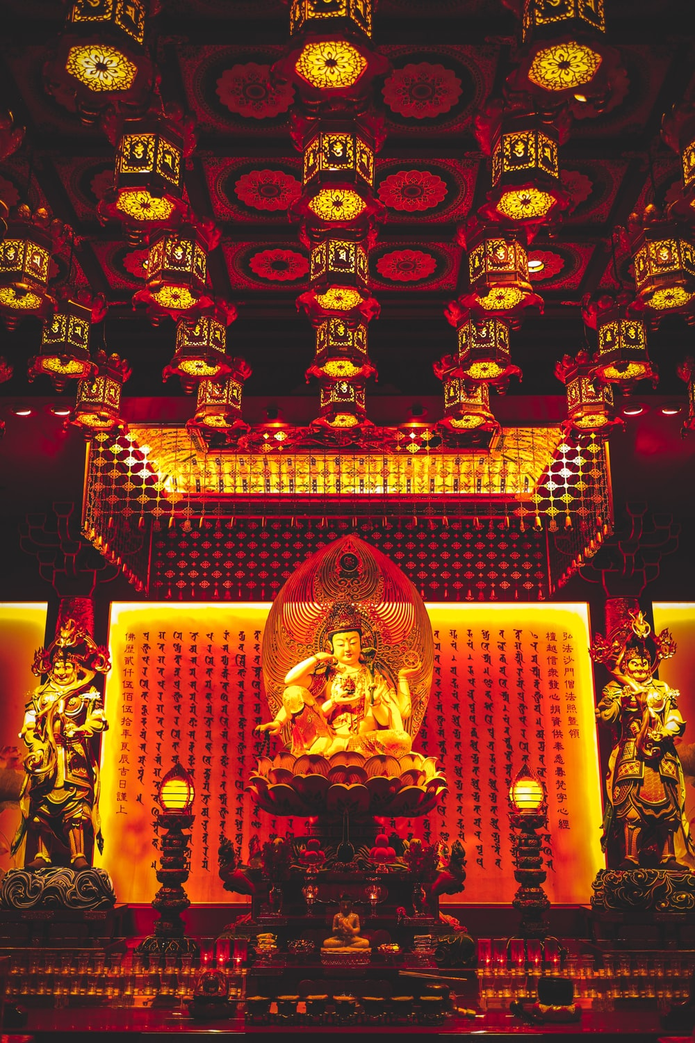Buddha statues inside building with lights