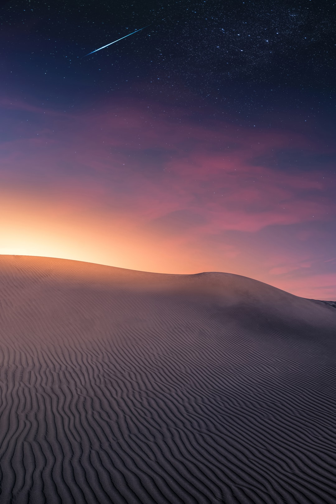 An image created with Adobe Photoshop starting from a photo taken in the dunes of a desert to the Canary Islands.