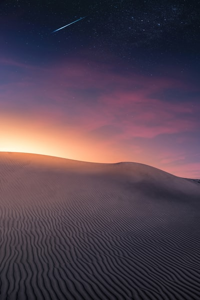 An image created with Adobe Photoshop starting from a photo taken in the dunes of a desert to the Canary Islands. Instagram Account - @therawhunter
