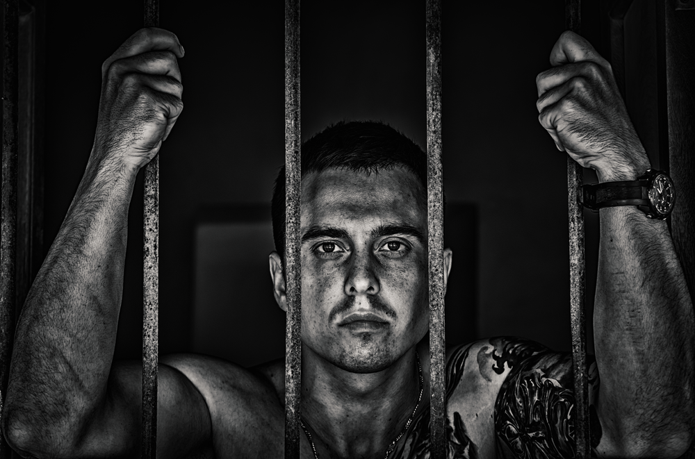 topless man inside cell