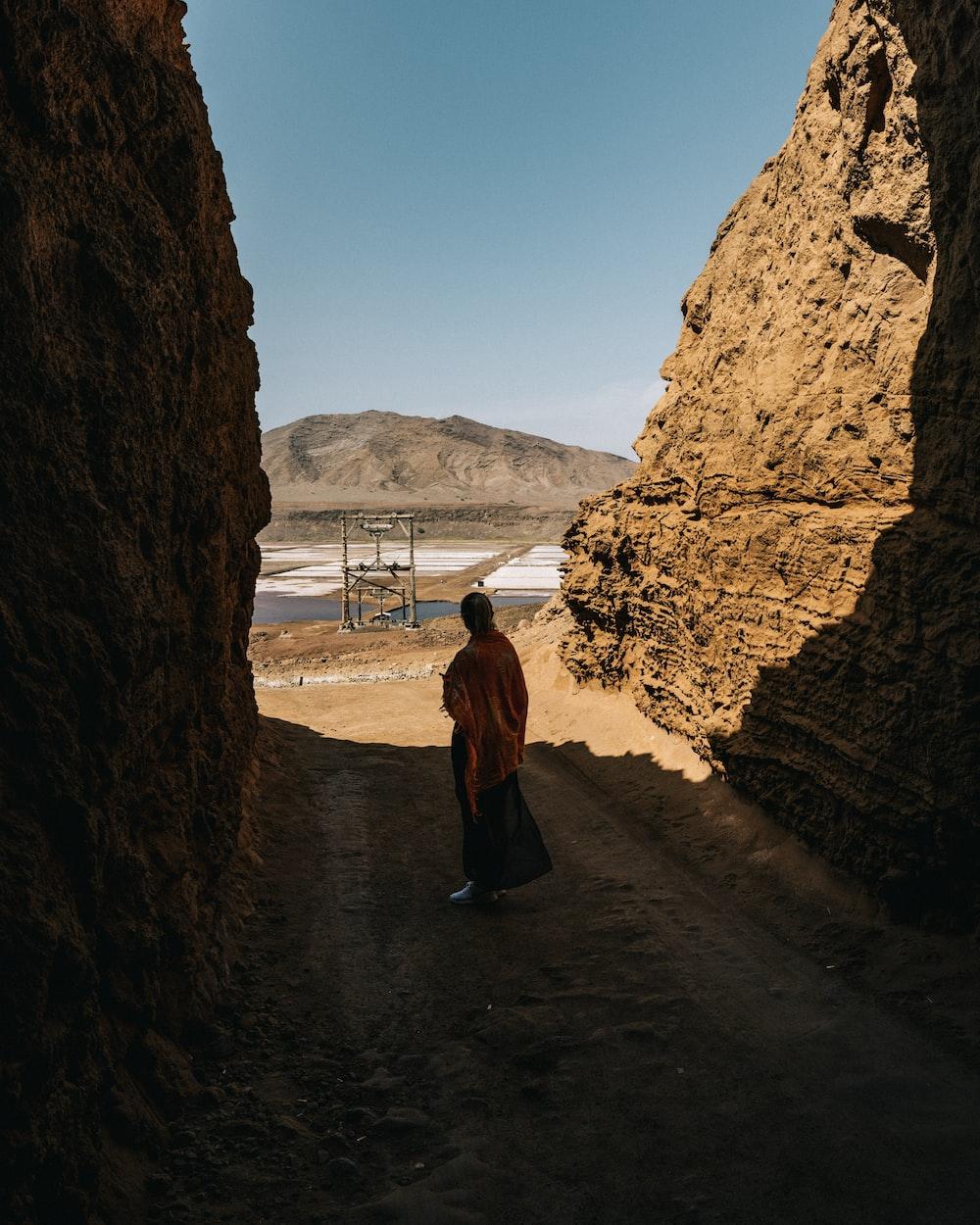 monk standing between cliff