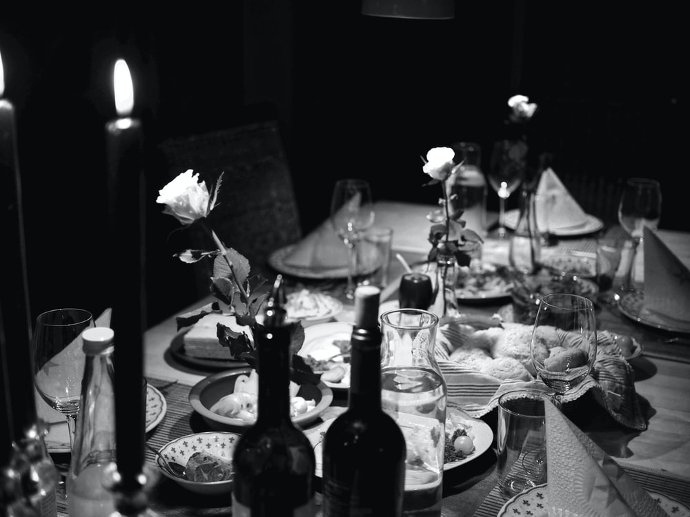 grayscale photo of cooked foods on table