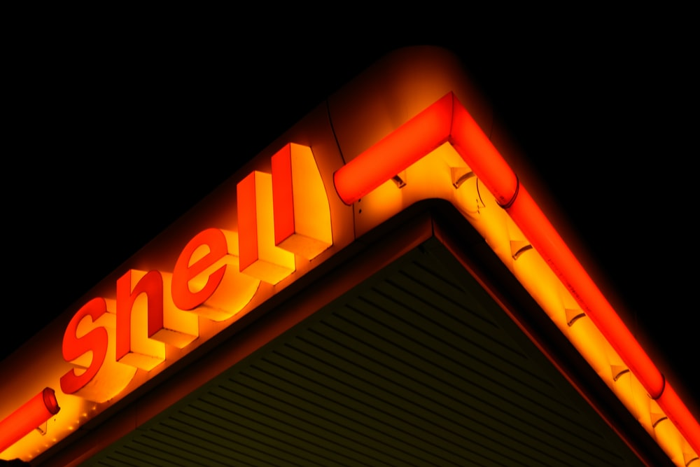 low angle photography of Shell gas station at night