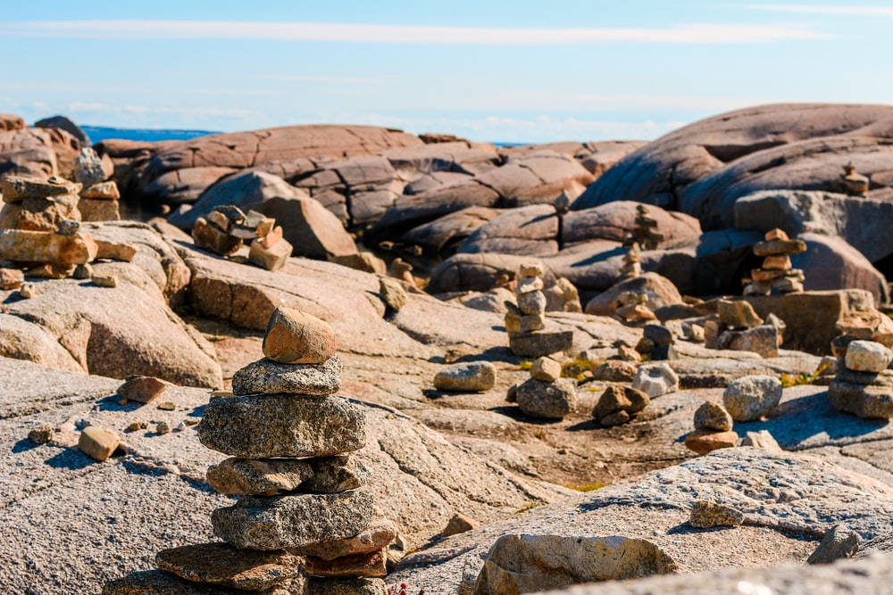 stone stacks on mountain under clear blue sky during daytime