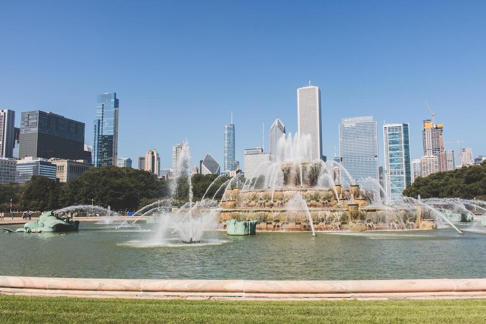 water fountain near high-rise buildings