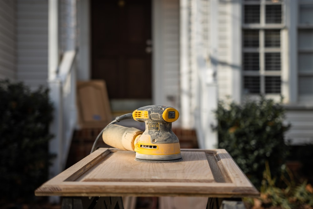 yellow and black wood router