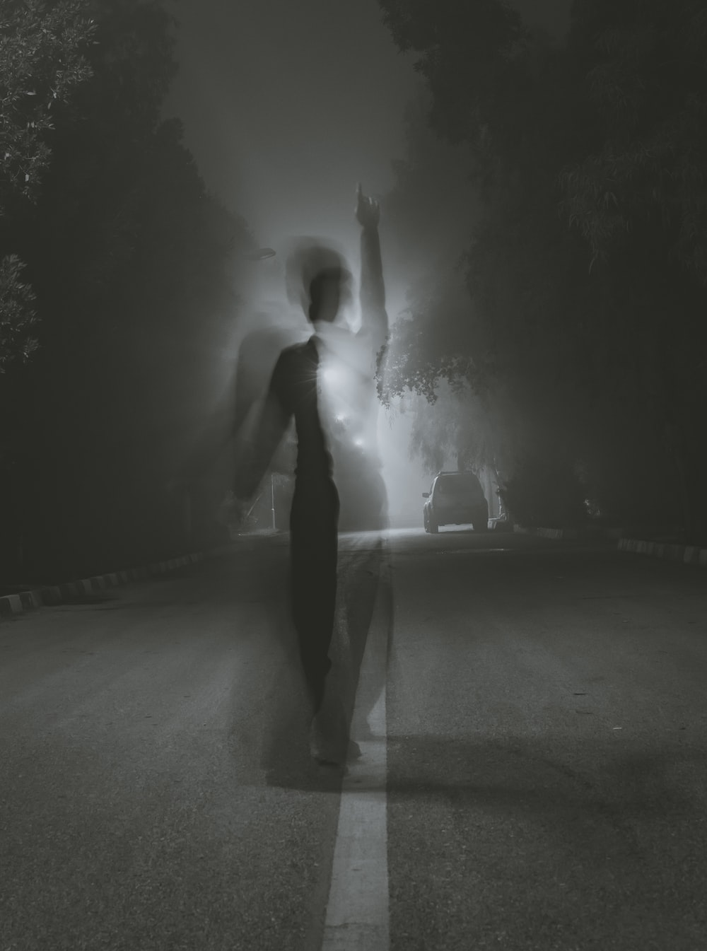 man standing at middle of road