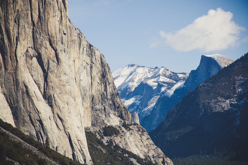 nature photography of rocky mountain under clear blue sky during daytime