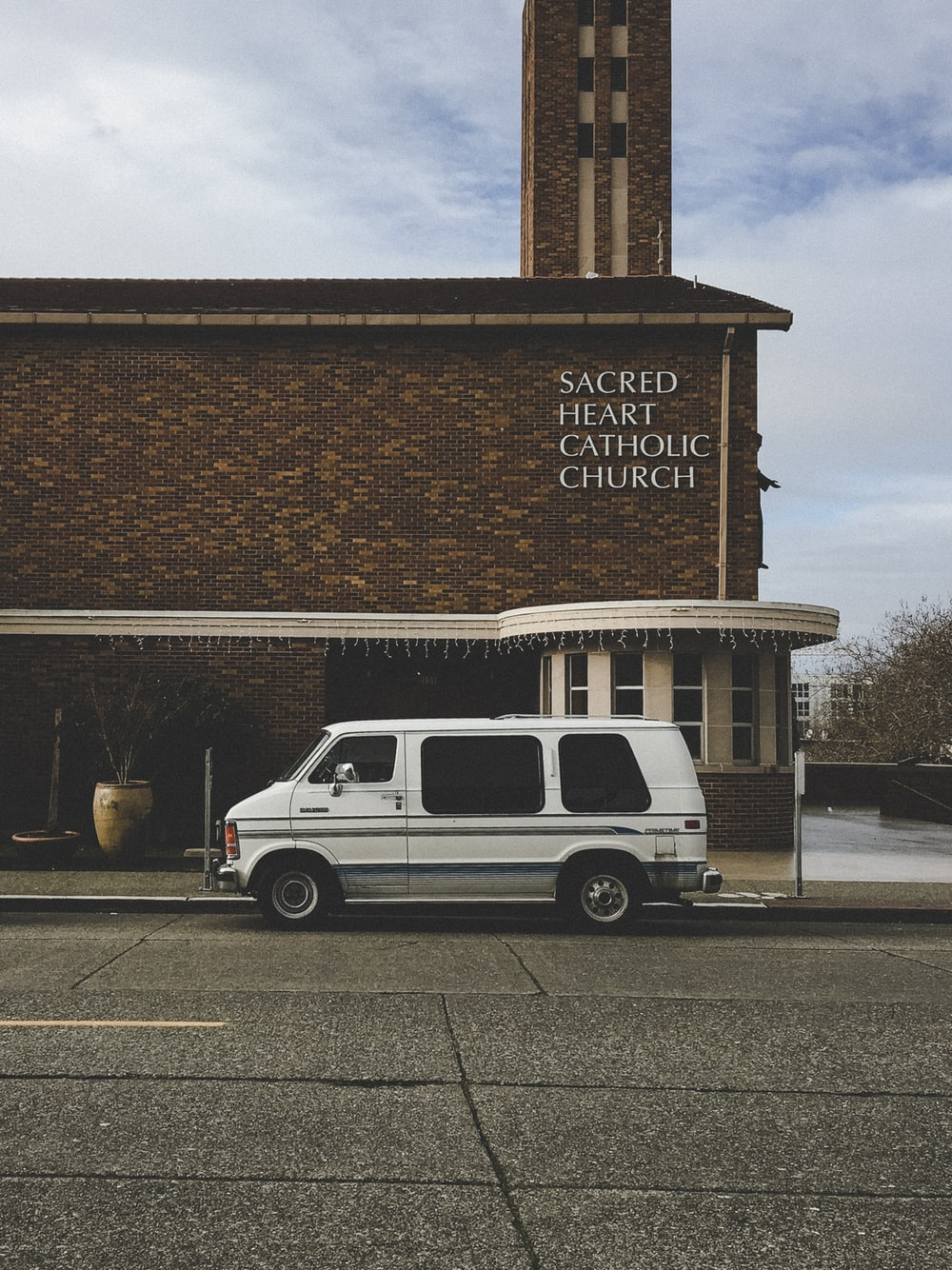 white custom van parked in front of church