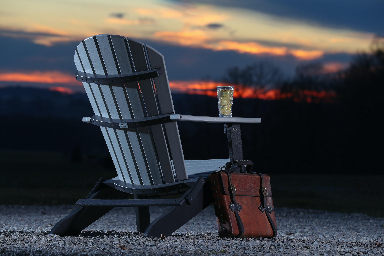 gray wooden armchair beside brown bag during golden hour