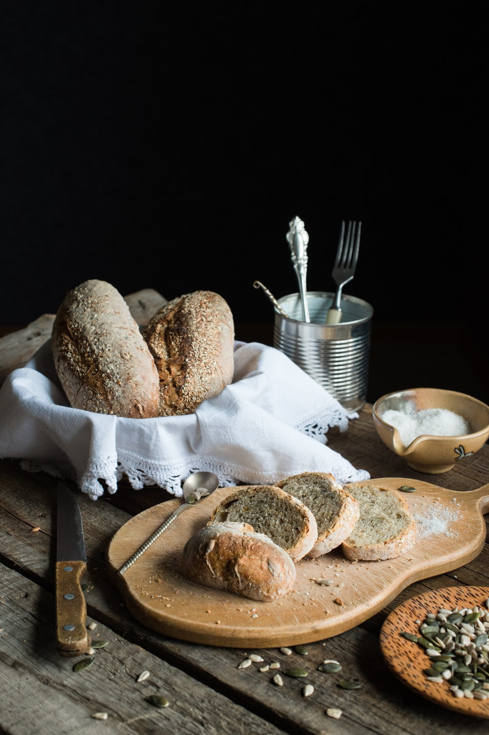 breads on brown chopping board