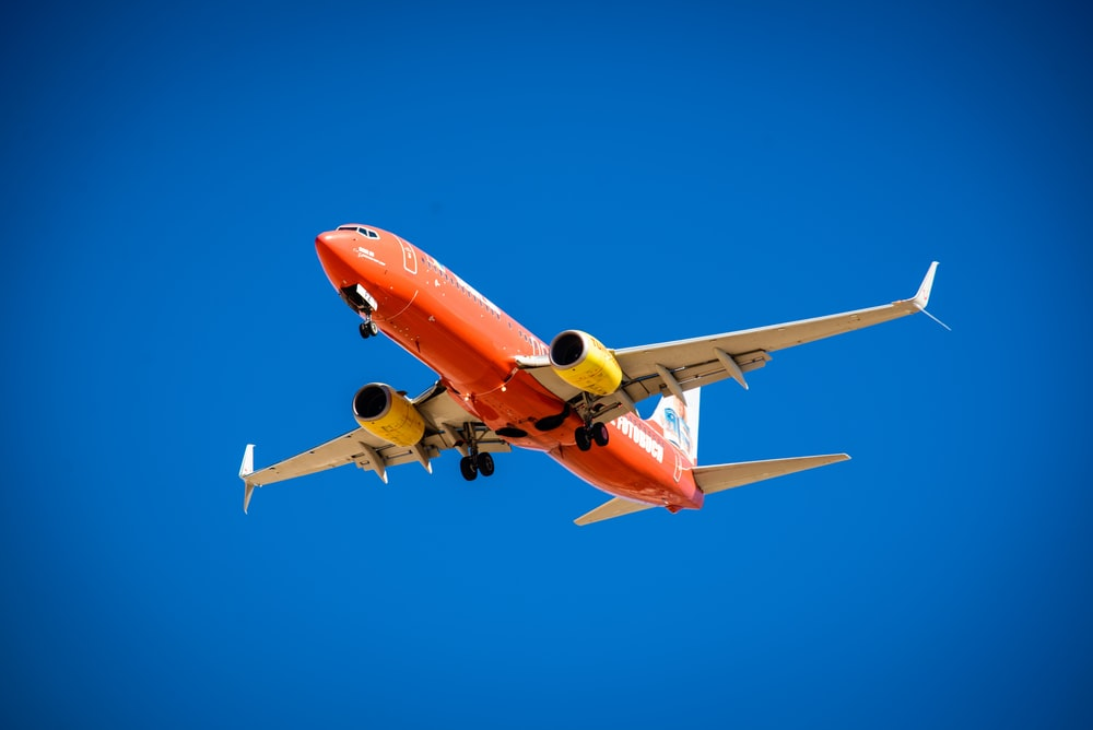 orange and white plane