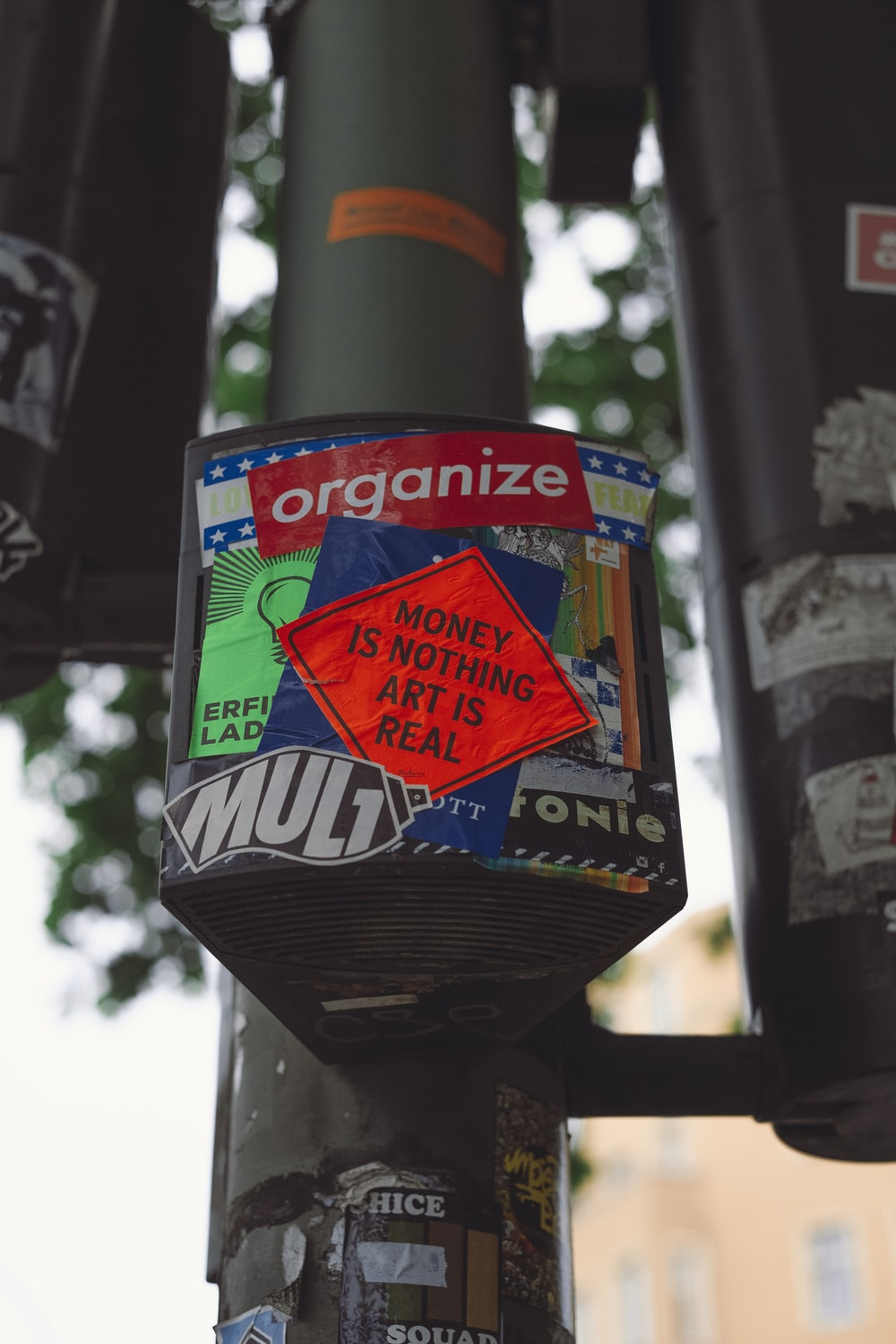red and blue stickers on pole