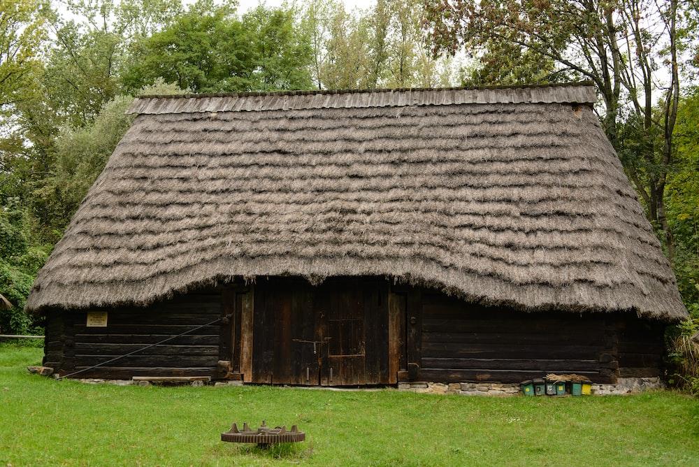 brown hut on grass land