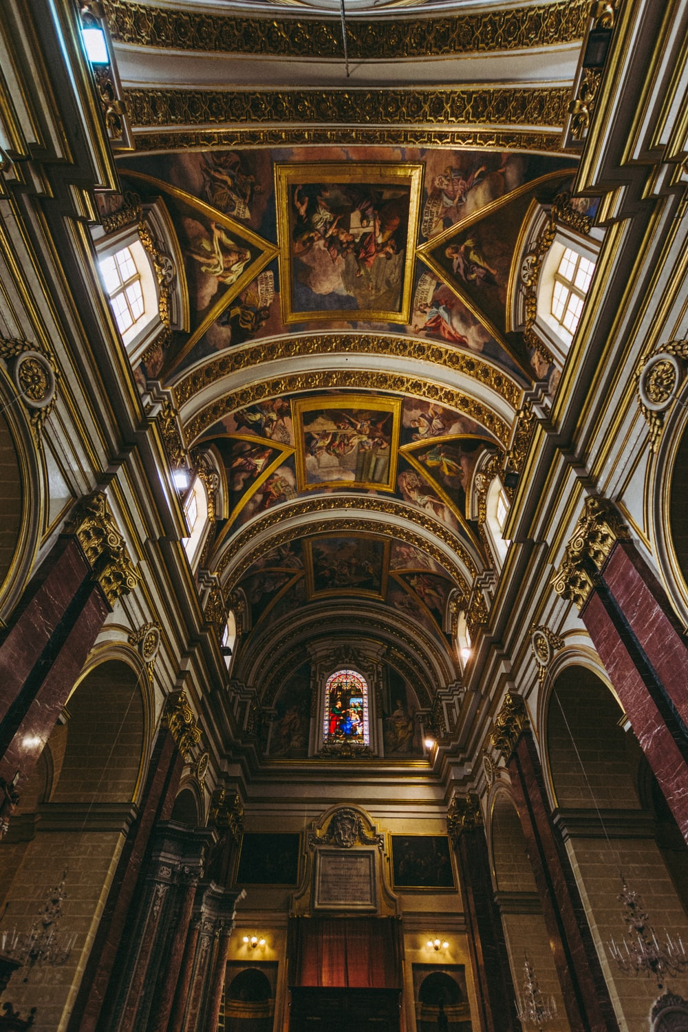 low-angle photography of ceiling paintings