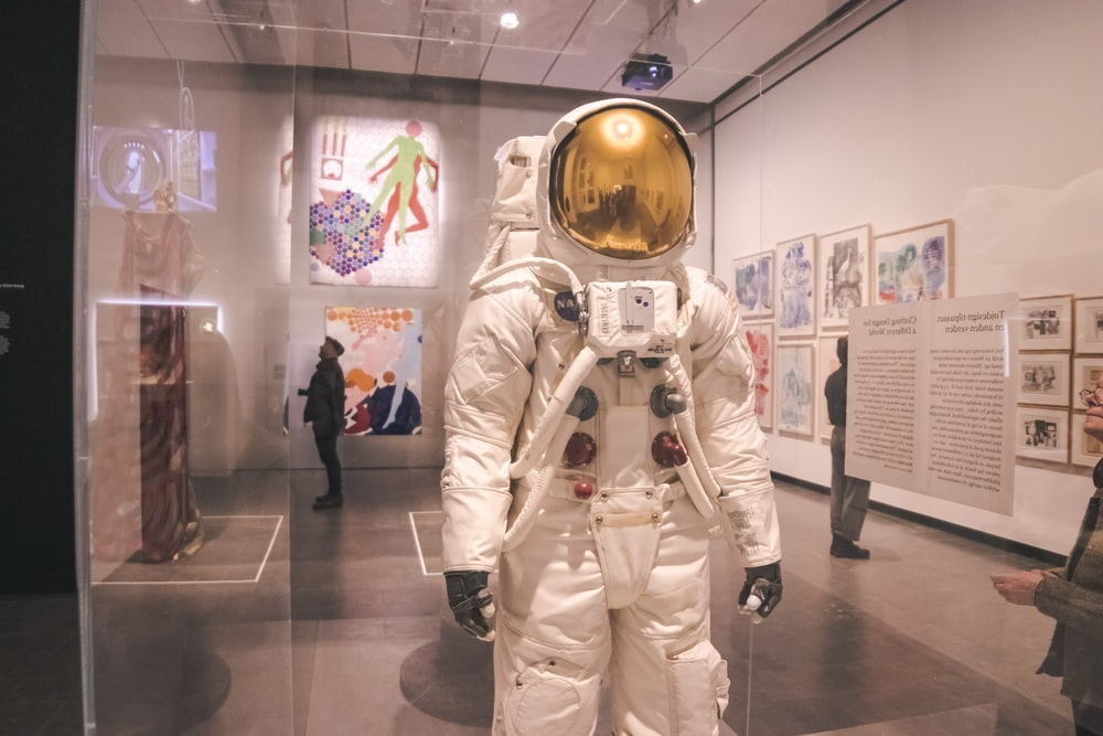 white astronaut suit on display in museum