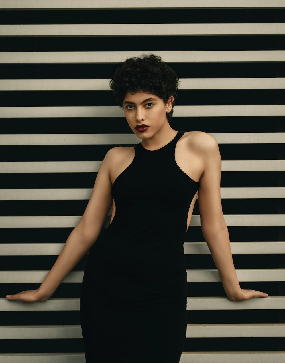woman wears black halter dress