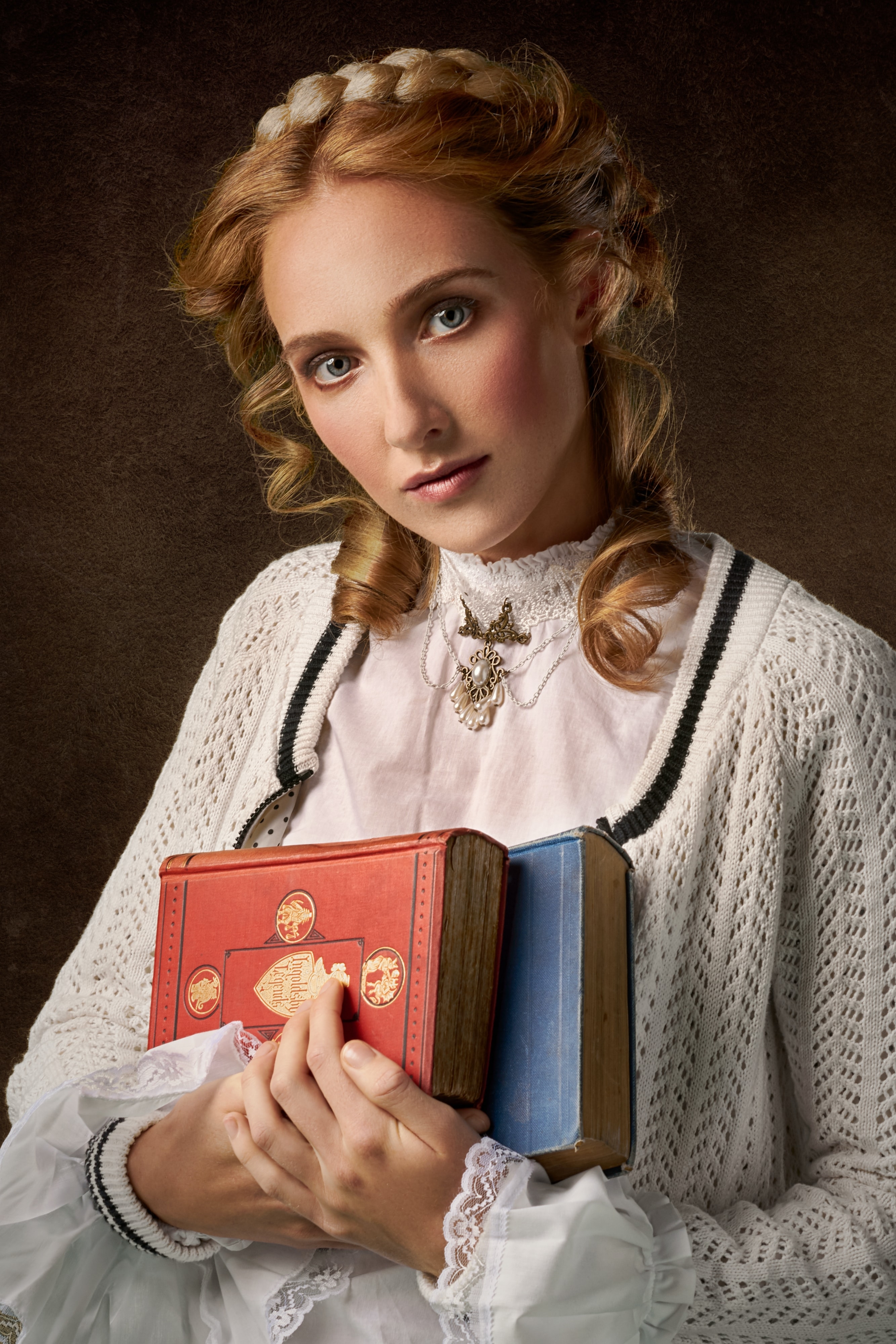 woman holding two books