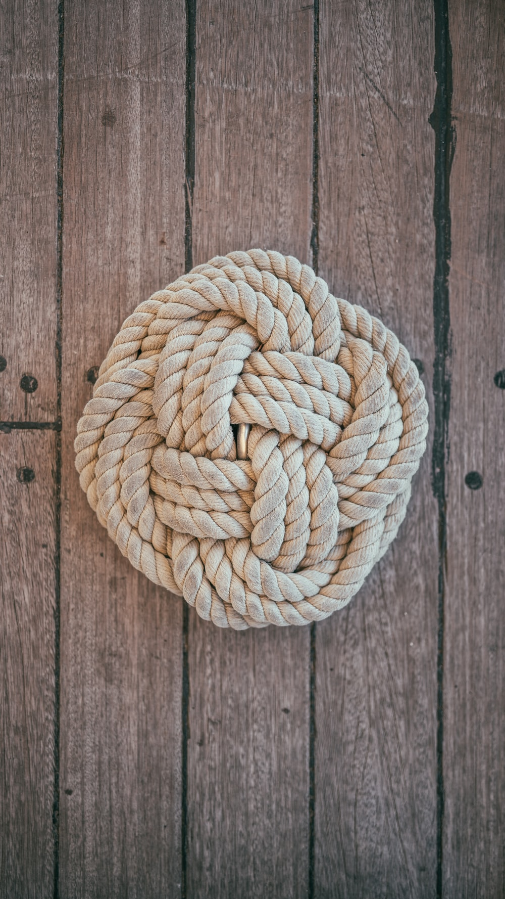 beige rope on brown surface