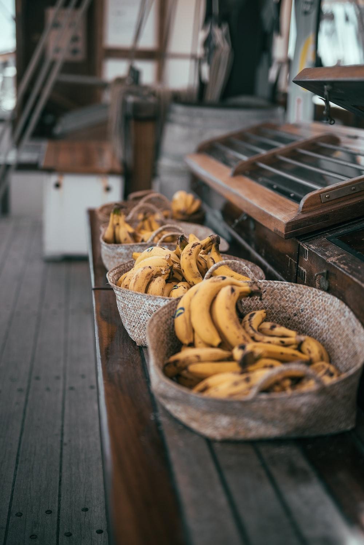 yellow banana fruits in brown basket