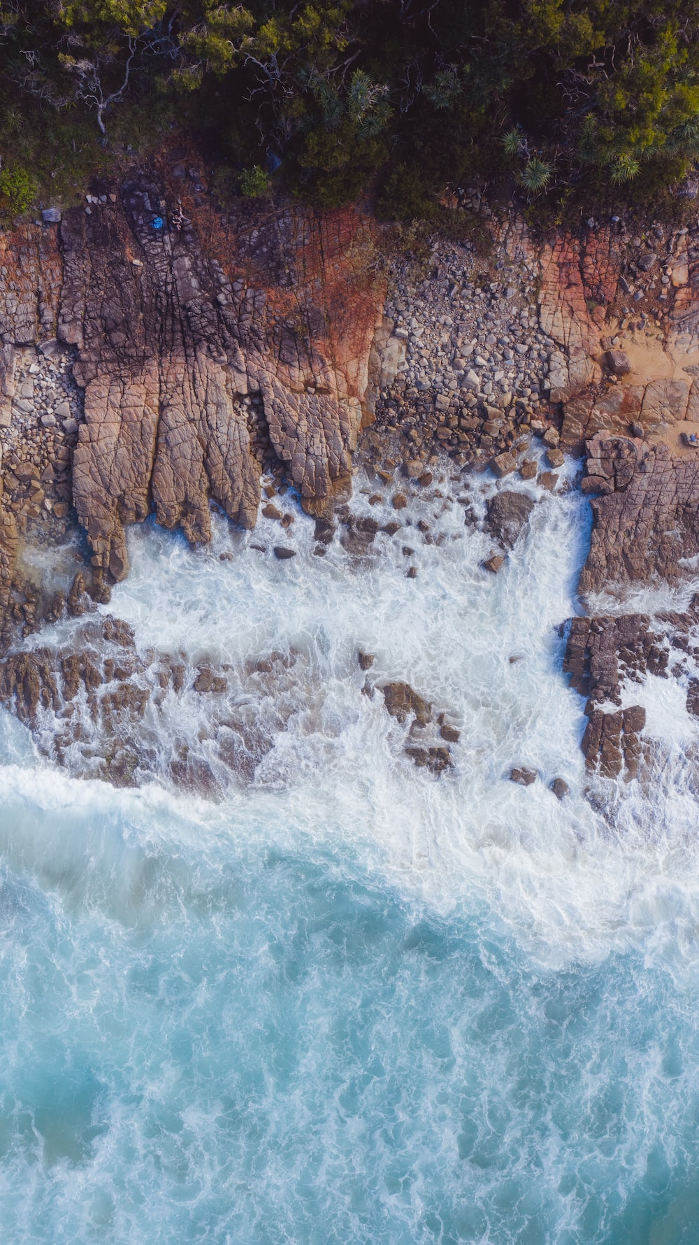 water falls by the cliff