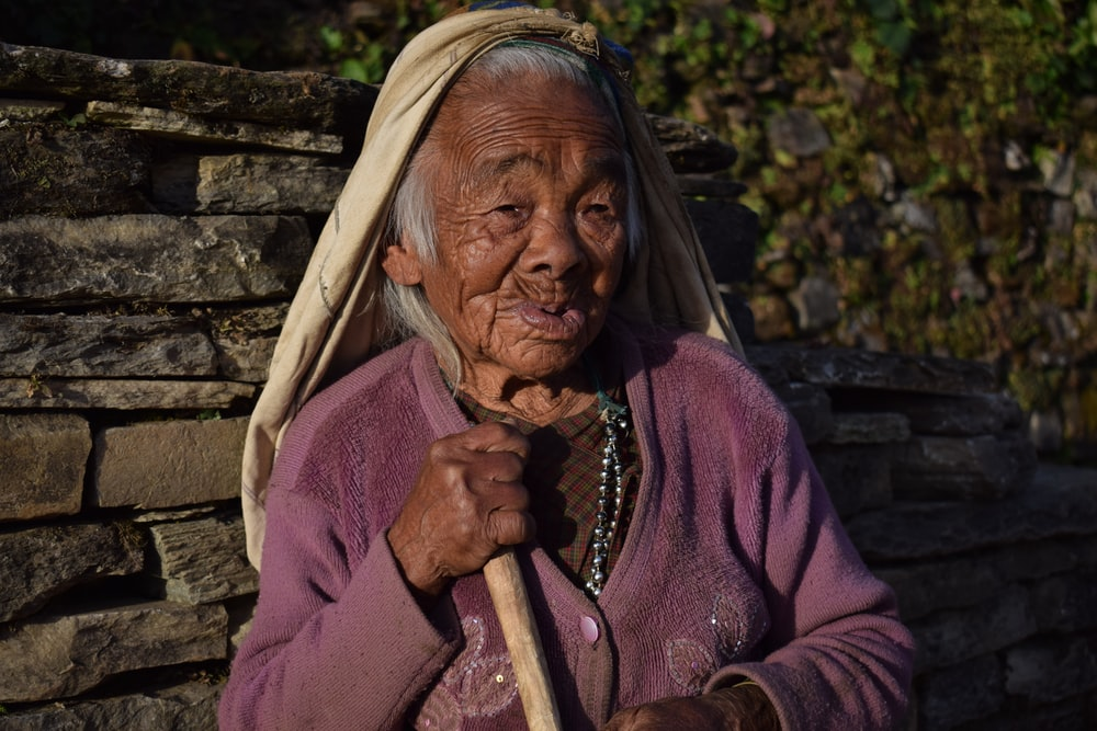 woman holding brown stick