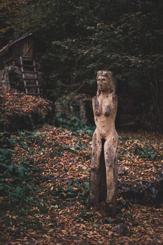 female profile sculpture near tree