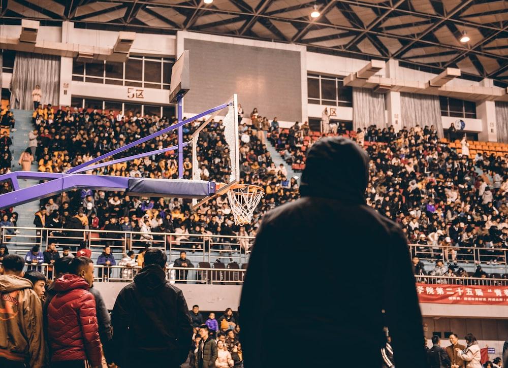 silhoutte of man watching basketball
