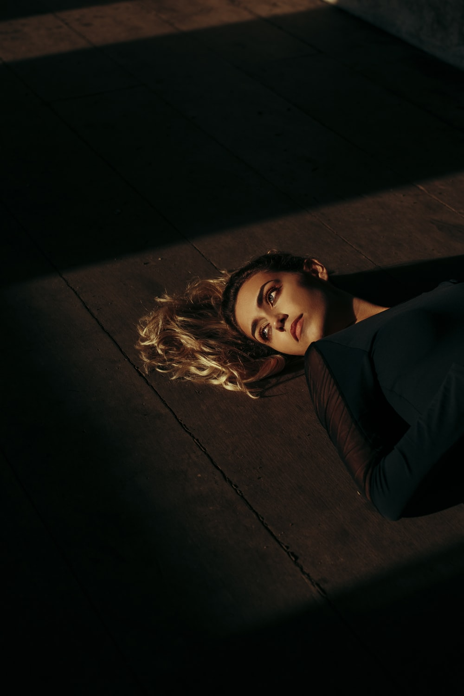 woman lying on floor