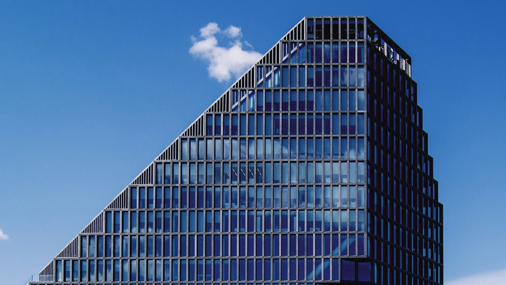 blue and gray glass window building