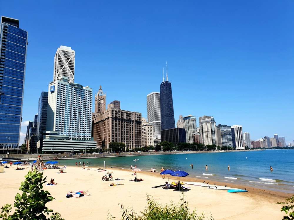 seashore beside high rise buildings