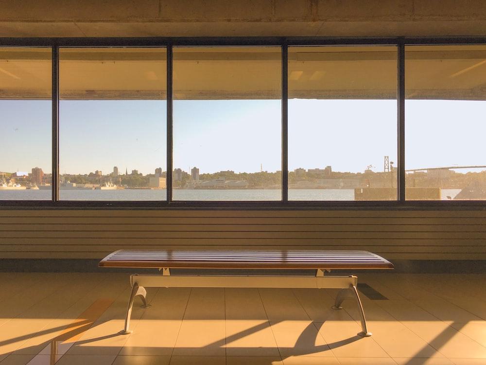 gray steel bench near window