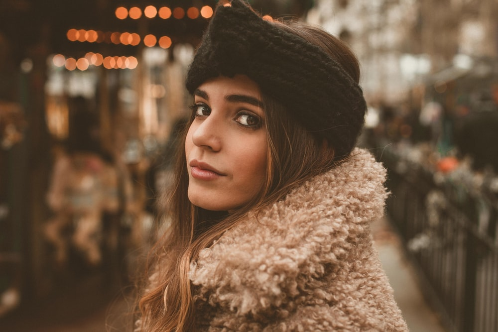 selective focus photography of woman wearing black knit headdress