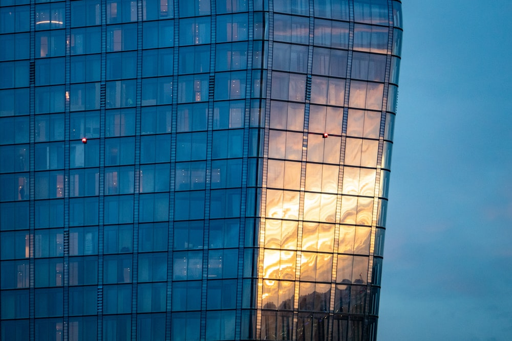 blue glass high rise building