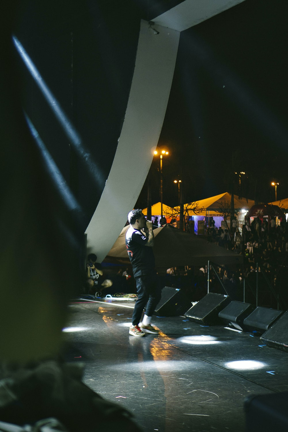 man performing on concert stage