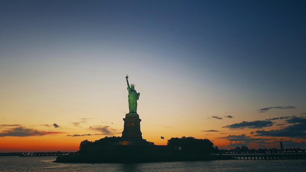 Statue of Liberty under dark sky