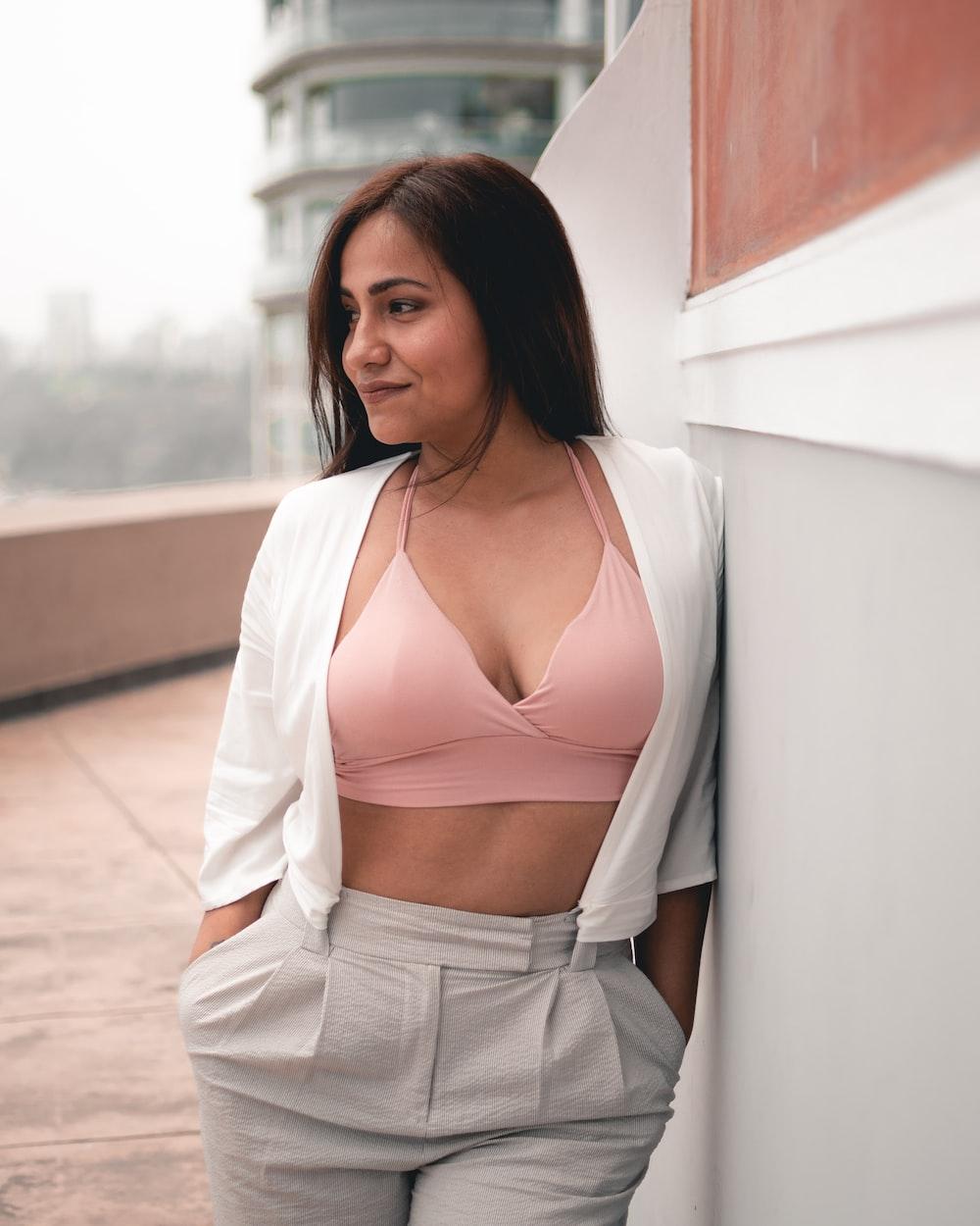 woman waering pink bra and white cardigan