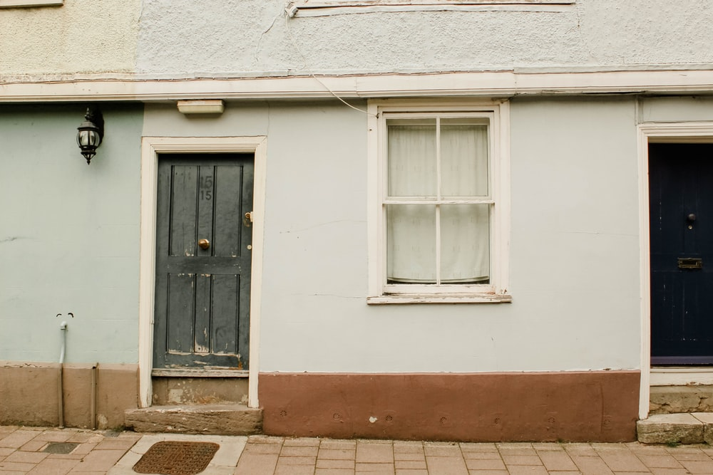 white painted house with black wooden door