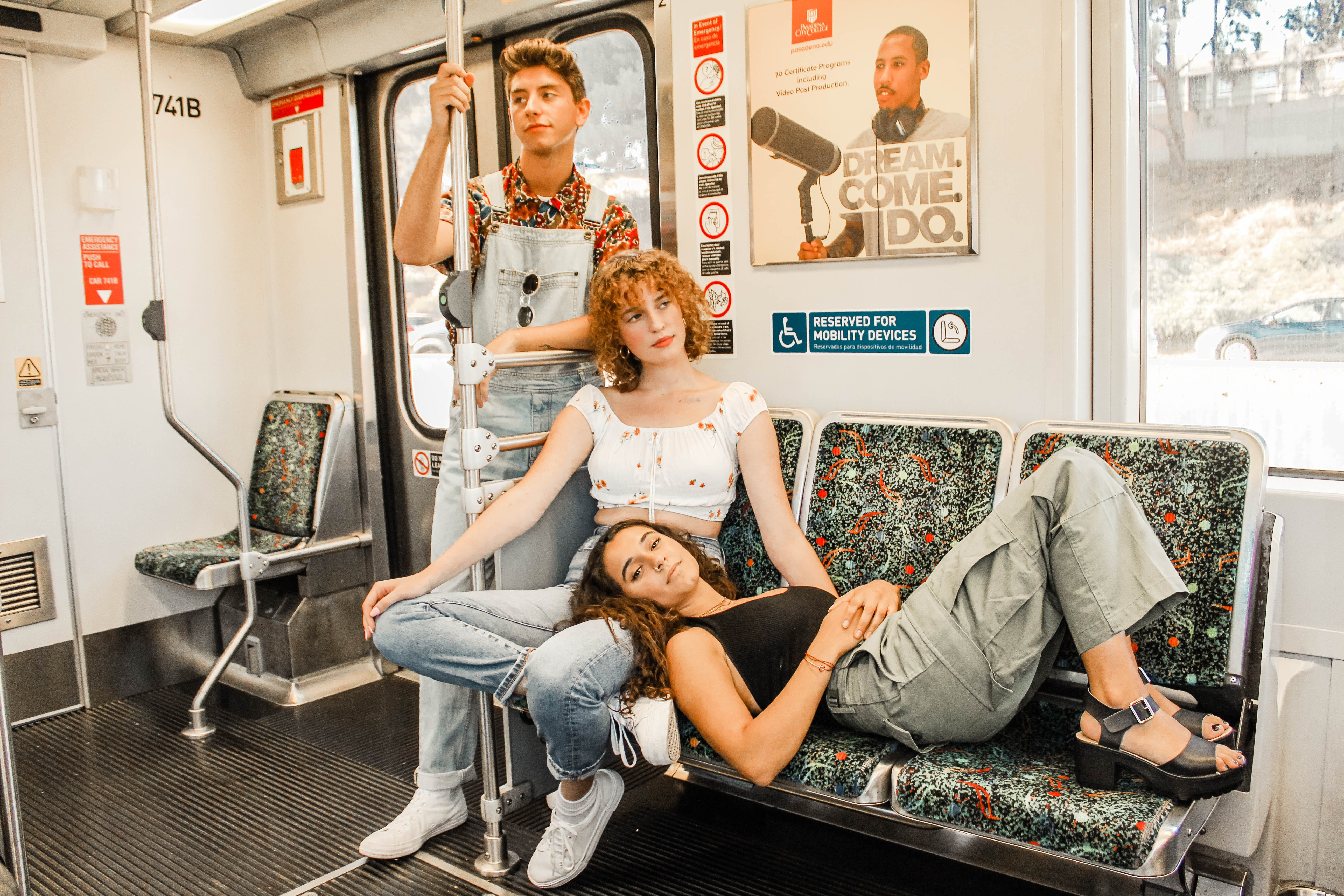 three people riding on train