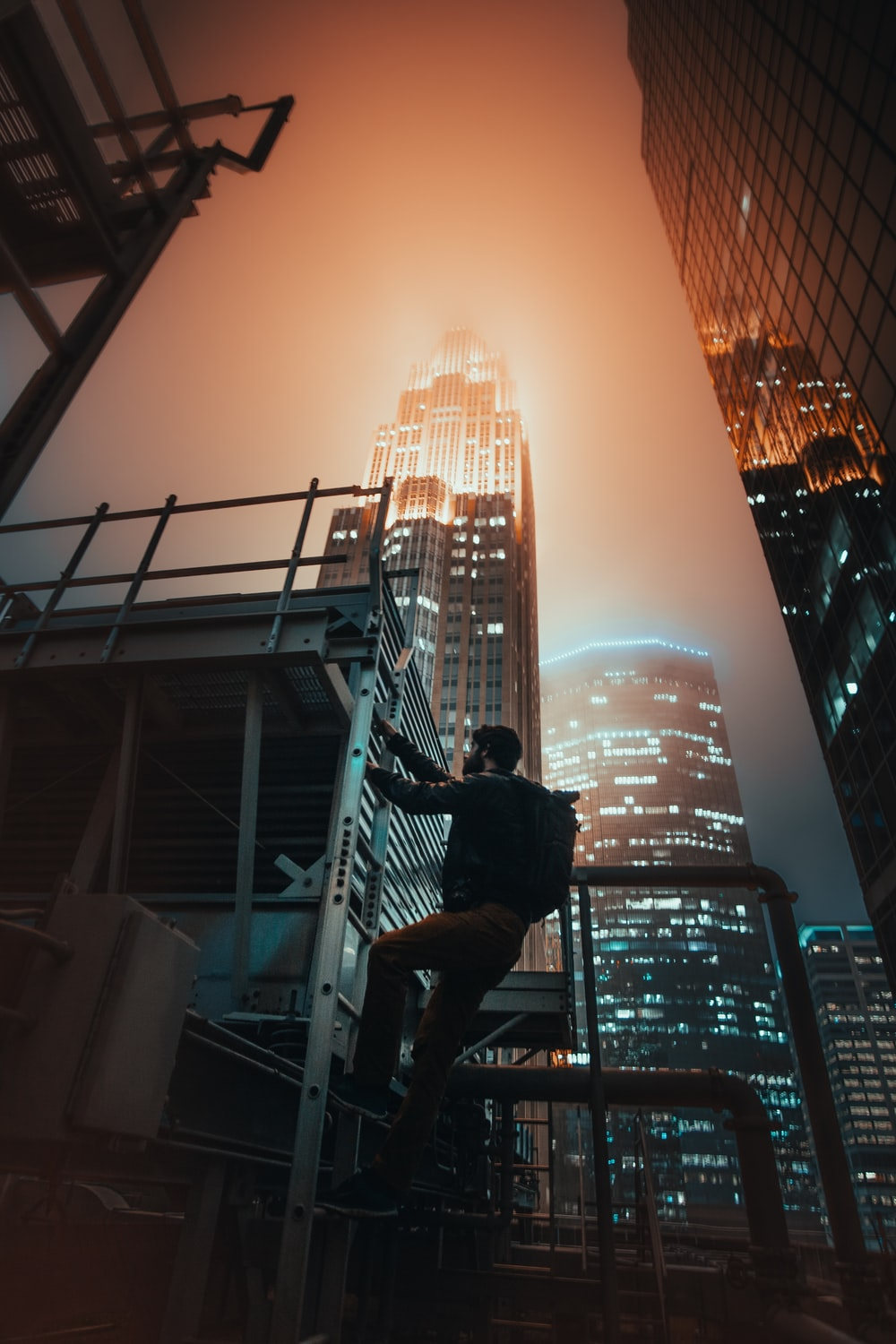 man climbing staircase by the building photo