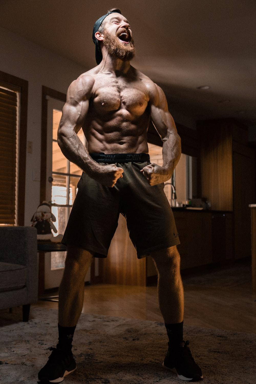 man flexing muscles